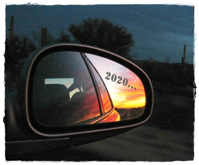 Sunset in a car's rearview mirror, with 2020 in text overlay
