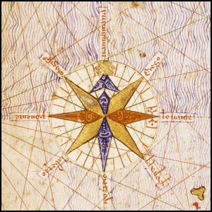 Antique image of a compass with ornate and colorful embellisments